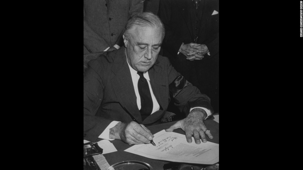 U.S. President Franklin D. Roosevelt signs the declaration of war against Japan on December 8, 1941. Italy and Germany immediately declared war on the United States, and on December 11, Roosevelt signed the U.S. declarations of war against those nations.