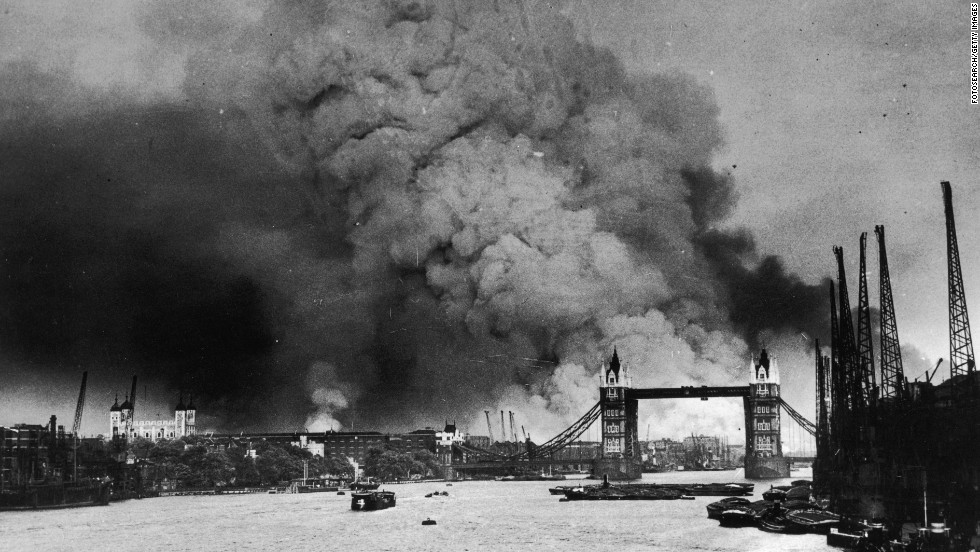 Smoke rises behind Tower Bridge during the first mass daylight bombing of London on September 7, 1940.