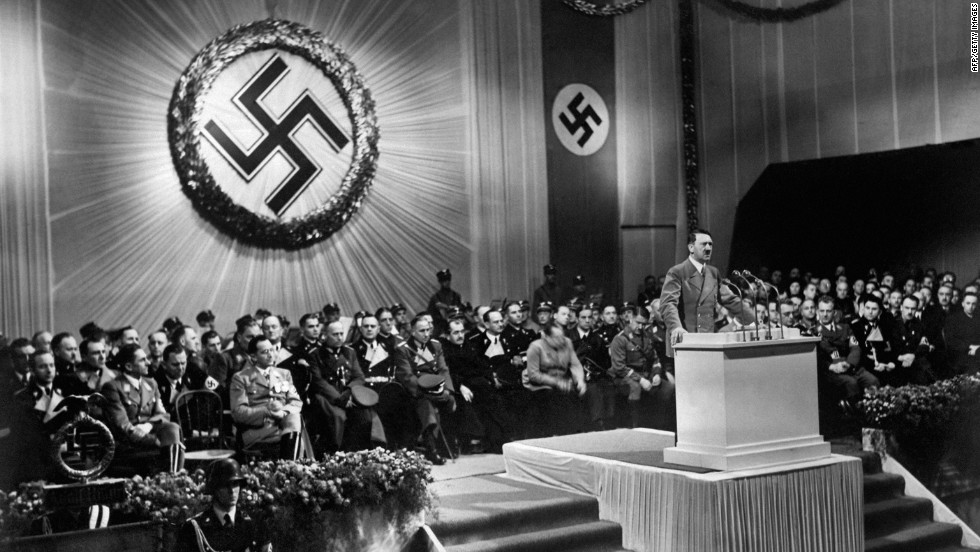 German Chancellor Adolf Hitler speaks to Nazi party officials in 1939, the year of the German blitzkrieg into Poland. Denmark, Luxembourg, the Netherlands, Norway and Belgium soon fell under German control. When France came under occupation less than a year later, Britain was the only remaining Western European nation fighting the Third Reich, and the United States had not yet entered the war.