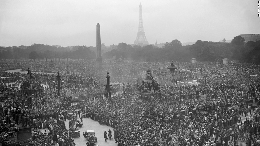 A crowd gathers to cheer Gen. Charles de Gaulle at the Place de la Concorde on August 26, 1944, a day after the liberation of Paris.