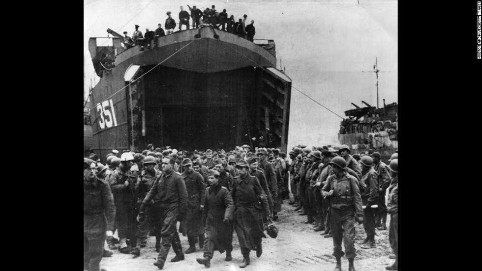 German prisoners captured at the beachhead of Anzio, Italy, leave a landing craft on their way to a prison camp in 1944. The amphibious landing and ensuing battle helped Allied forces break a months-long stalemate south of Rome and ultimately defeat the Germans in Italy.