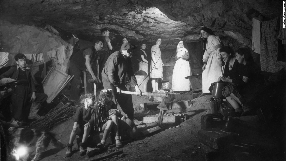 French refugees live in a quarry near Fleury sur Orne. During the bombing in that area, 20,000 refugees lived in the quarries.