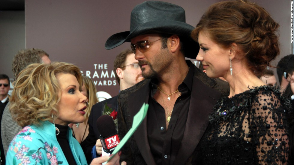 Rivers talks with Tim McGraw and his wife, Faith Hill, at the Grammys in 2005.