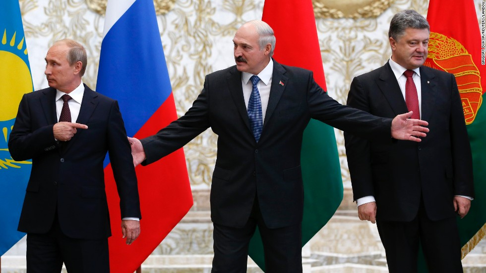 "From left, Russian President Vladimir Putin, Belarusian President Alexander Lukashenko and Ukrainian President Petro Poroshenko react while posing for a picture during their meeting in Minsk, Belarus, on Tuesday, August 26. Ukraine's President called for ""resolute actions that will bring peace"" to his country."