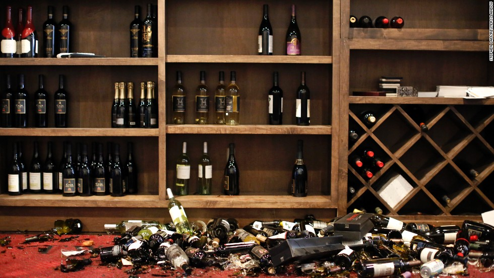 "Broken bottles lie on the ground at the Cult Following Wine Bar in Napa, California, after a <a href=""http://www.cnn.com/2014/08/24/us/gallery/ca-earthquake/index.html"">magnitude-6.0 earthquake</a> on Sunday, August 24. It was the strongest quake to hit the San Francisco Bay Area in 25 years."