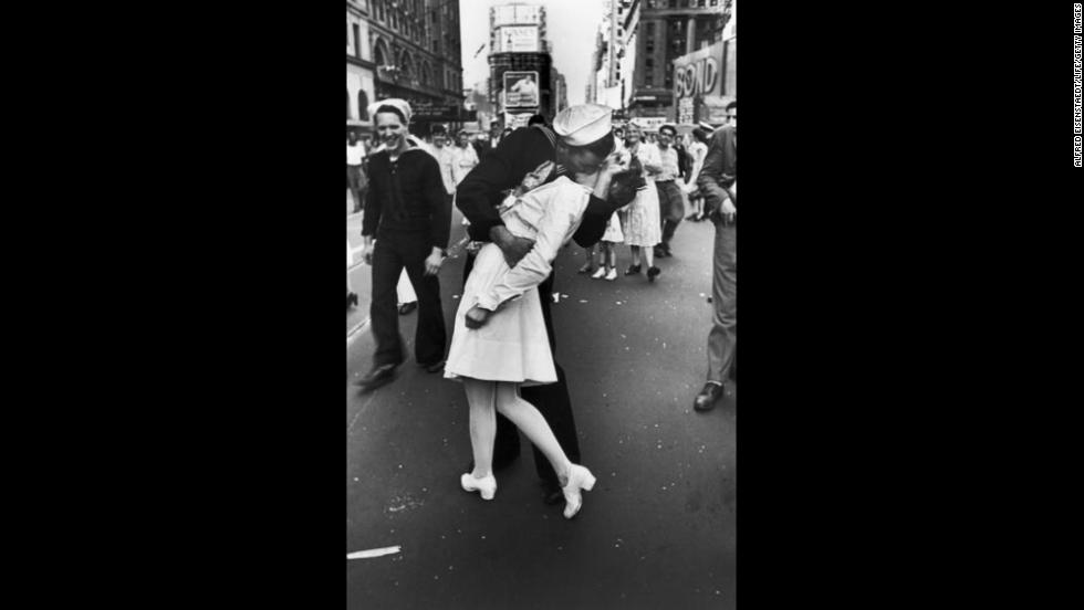 A jubilant American sailor kisses a nurse in New York's Times Square on August 14, 1945, as he celebrates the news that Japan has surrendered. (Because of the time difference between the two nations, the surrender occurred August 15 in Japan).