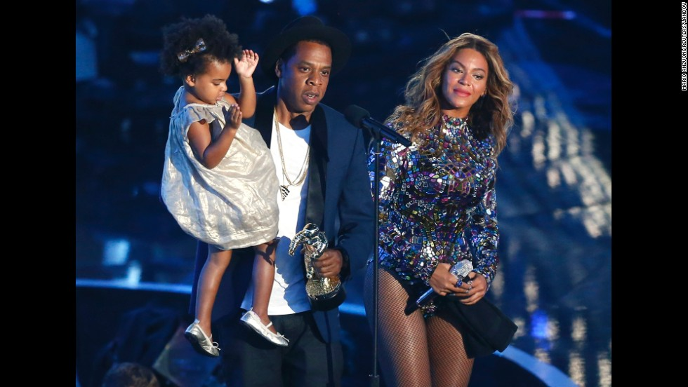 "Jay-Z presents the Video Vanguard Award to Beyonce as he holds their daughter, Blue Ivy, during the <a href=""http://www.cnn.com/2014/08/25/showbiz/gallery/mtv-vmas-2014/index.html"">2014 MTV Video Music Awards</a> in Inglewood, California, on Sunday, August 24."