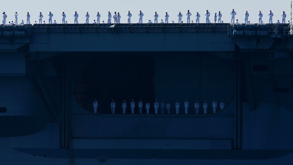 Sailors man the rails of the USS Carl Vinson aircraft carrier as it departs its home port in San Diego on Friday, August 22. The ship was deployed to the Western Pacific and Middle East.