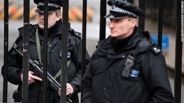 "Armed policemen stand guard at the gates of Downing Street in London on January 23, 2010. Britain raised its assessment of the terror threat from substantial to severe, the second highest level, suggesting an attack on the country is ""highly likely"", Home Secretary Alan Johnson said. The change was announced just weeks after a failed plane bombing in the United States, and days ahead of two major international conferences on Yemen and Afghanistan in London. AFP PHOTO/Ben Stansall (Photo credit should read BEN STANSALL/AFP/Getty Images)"