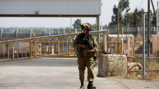 An Israeli soldier walks near a border crossing Sunday in Quneitra. Israel shot down a drone over the area with a Patriot missile.