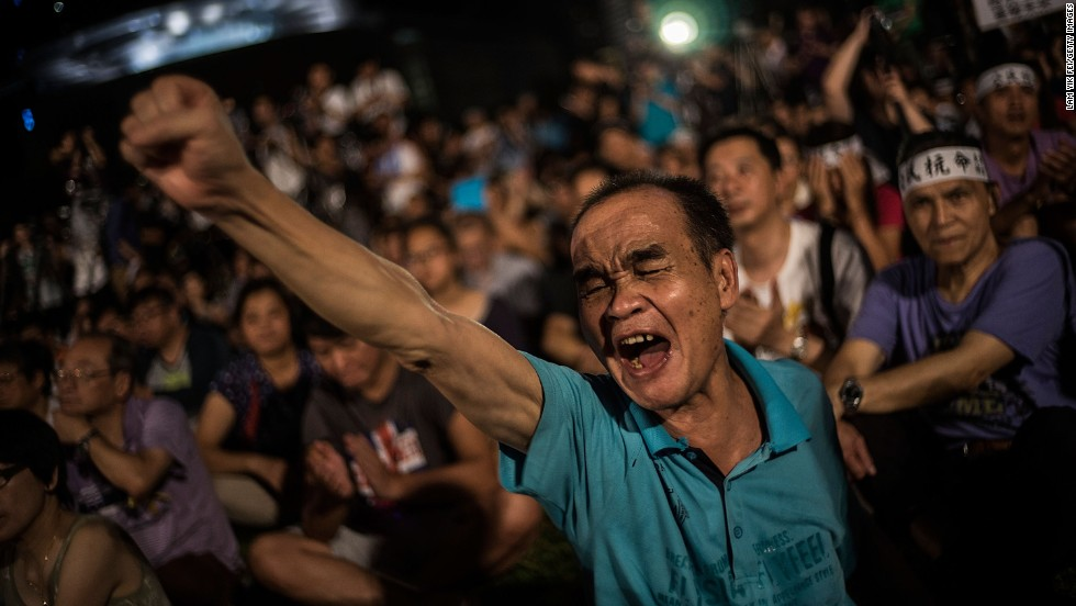 Hong Kong protesters denounce the Chinese government on August 31, 2014, after Beijing announced candidates for Hong Kong's next leader must be approved by a Beijing-backed committee.