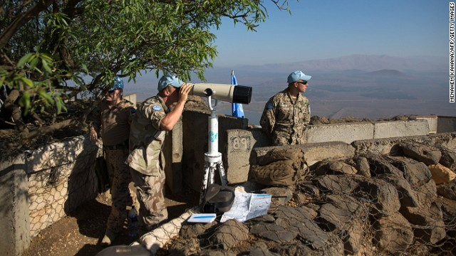U.N. Disengagement Observer Force troops watch the Syrian side of the Golan Heights at Mount Bental in late August.