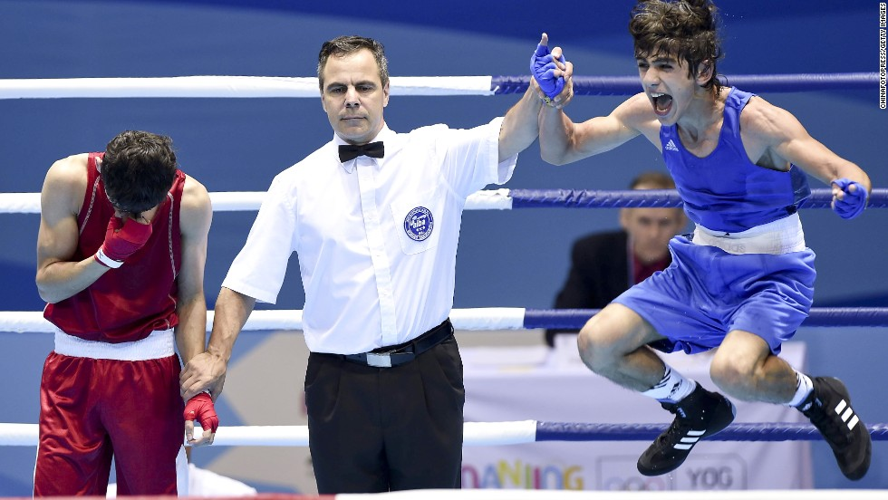 Boxer Rufat Huseynov of Azerbaijan celebrates after beating Uzbekistan's Sulaymon Latipov to win gold Wednesday, August 27, at the Youth Olympic Games in Nanjing, China.