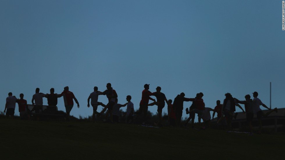 The Sydney Swans, an Australian rules football club, stretch together at Sydney's Clovelly Beach on Sunday, August 31.