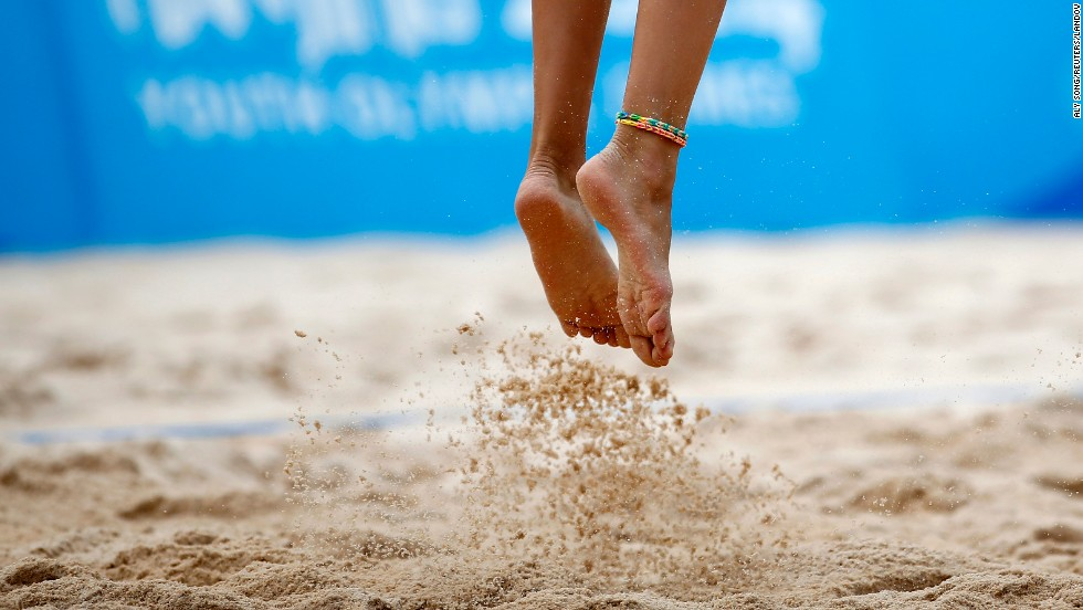 Russia's Nadezda Makroguzova jumps for a serve Tuesday, August 26, during a beach volleyball match at the Youth Olympic Games in Nanjing, China.