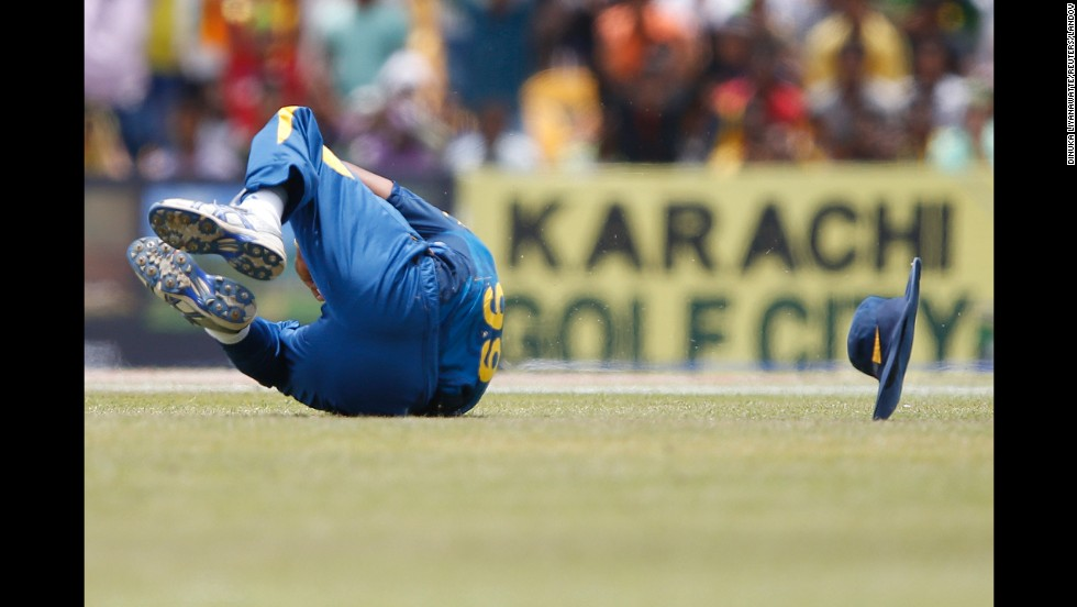 Sri Lankan cricketer Lasith Malinga dives for a catch during the One Day International match against Pakistan on Saturday, August 30.
