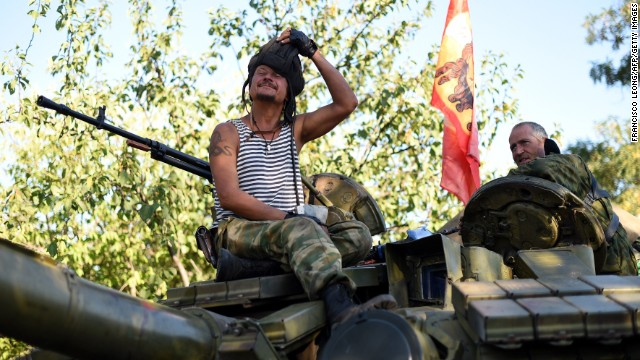 Pro-Russian fighters sit ontop of their T-64 tank in Starobesheve, southeast of Donetsk, on August 31, 2014.