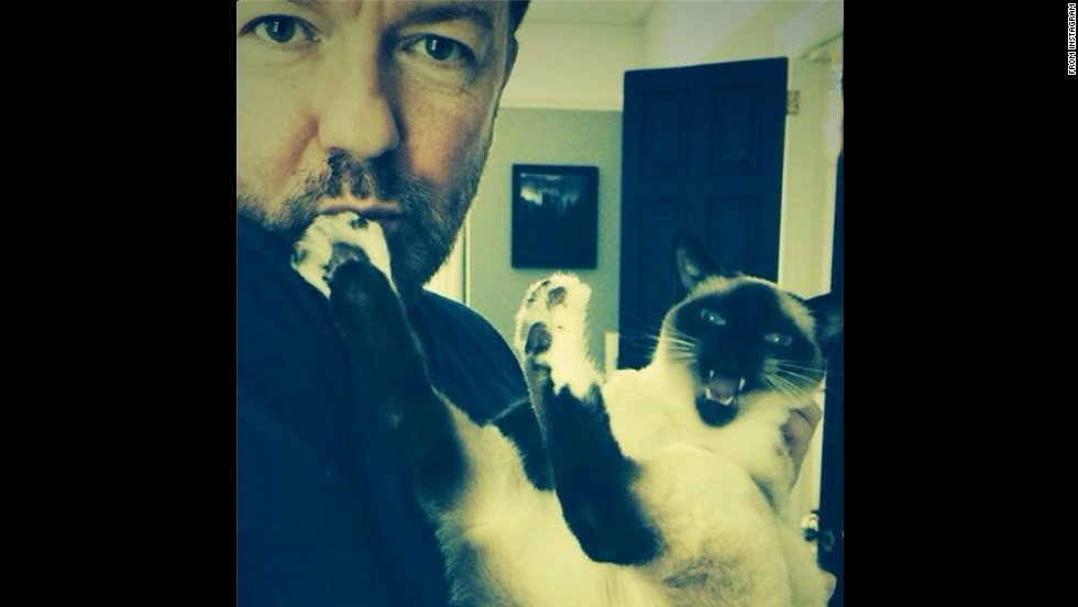 "Comedian Ricky Gervais holds up a cat in this selfie <a href=""http://instagram.com/p/sVCUW-l432/"" target=""_blank"">posted to Instagram</a> on Saturday, August 30. ""Bagpipes,"" he wrote."
