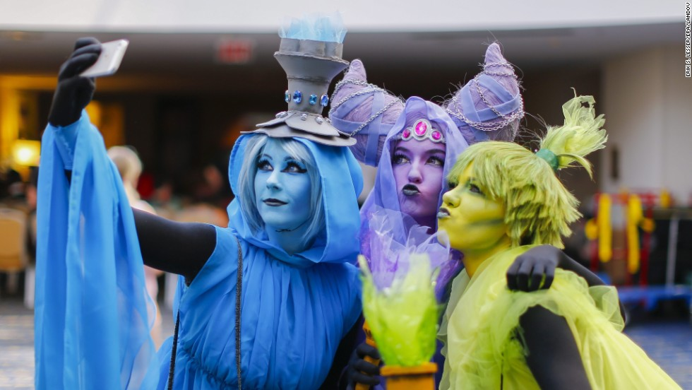 "From left, Boston residents J.J. Pyrope, Regan Cerato and Kelly Sconson take a selfie Friday, August 29, during the Dragon Con convention in Atlanta. They were dressed up as the Poe Sisters from the ""Legend of Zelda"" video game series."
