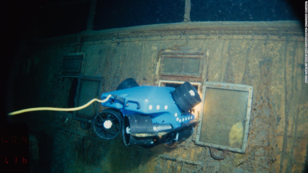"For the Titanic dives, a prototype Remotely Operated Vehicle called ""Jason Jr."" was deployed to photograph the wreck. Here you can see Jason Jr. peering into the stateroom on the Titanic."