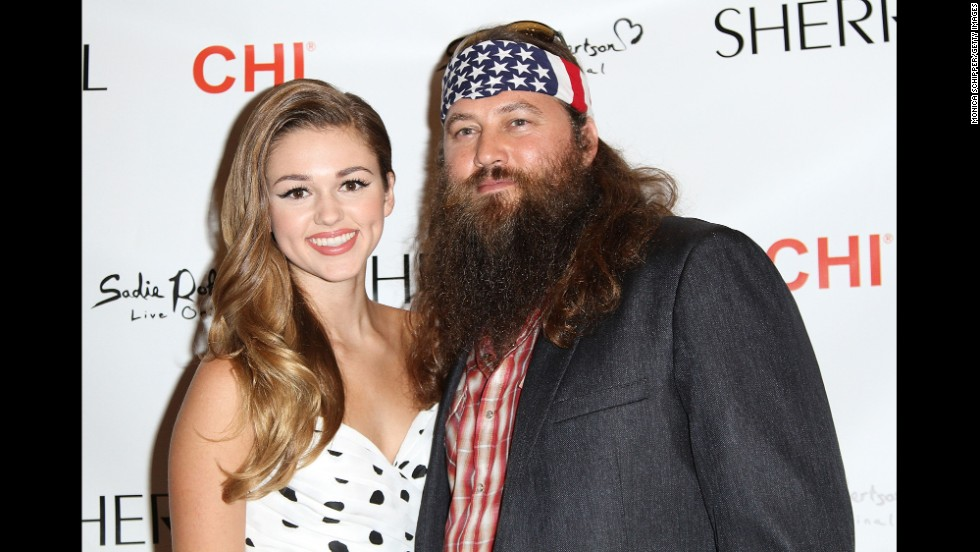 """Duck Dynasty"" star Sadie Robertson, pictured with her dad, Willie, jokes that her family isn't too big on dancing, but she may be able to squeeze in some practice with Uncle Si. If she can't, there's always her pro partner, Mark Ballas."