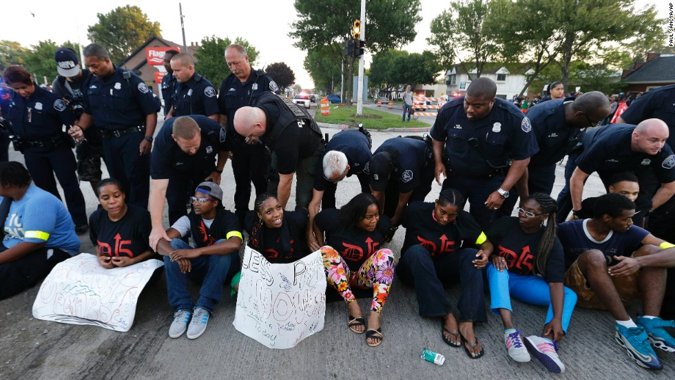 Police handcuff protesters blocking traffic in Detroit on September 4.