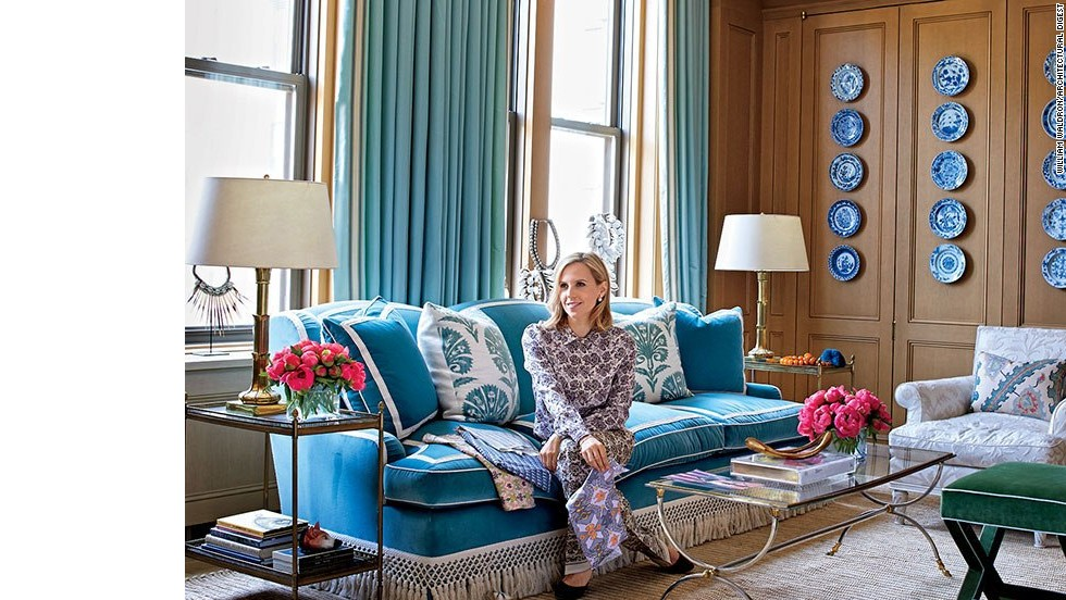 "Burch perches on a cotton-velvet sofa in her office's sitting area. <a href=""http://www.architecturaldigest.com/decor/2014-09/tory-burch-manhattan-office-slideshow?mbid=synd_cnn"" target=""_blank"">See more photos on ArchDigest.com</a>"