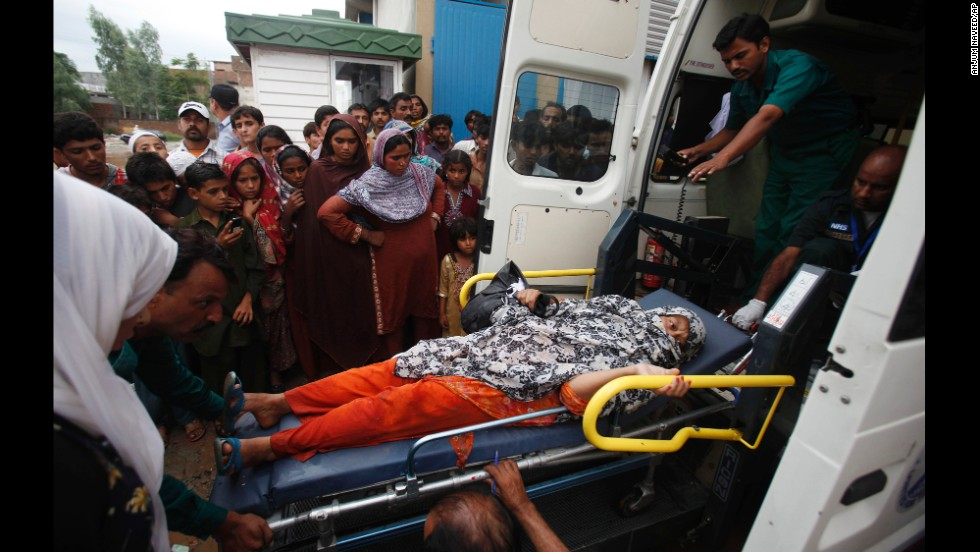 An injured woman is loaded into an ambulance after being rescued from a flooded area of Islamabad on September 5.