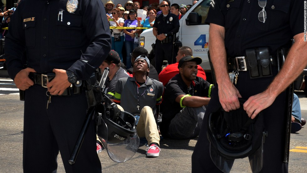 "People stage a sit-in before being detained by police outside a McDonald's in Los Angeles on Thursday, September 4.<a href=""http://money.cnn.com/2014/09/01/news/companies/fast-food-worker-strike/""> Fast-food workers protested in more than 150 U.S. cities</a> as they called for a mininum wage of $15 an hour and the right to form a union without retaliation."