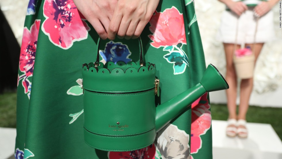 "One of Kate Spade's inspirations for spring 2015 was the concept of ""fresh starts,"" playing with elements of grass and gardening as seen with this watering can bag."