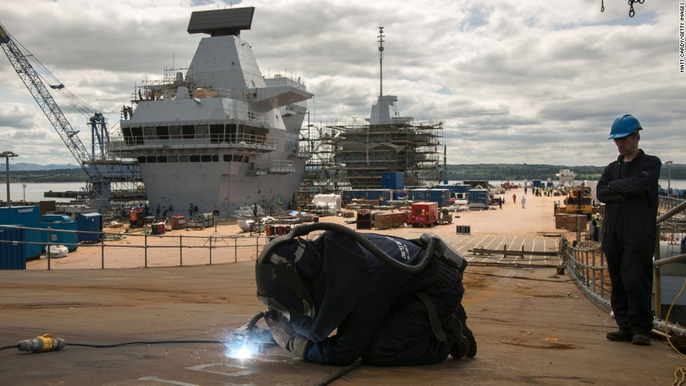 Scotland has strong construction sector. Pictured here is a construction worker on the flight deck of HMS Queen Elizabeth aircraft carrier being in Rosyth Dockyard in Scotland.