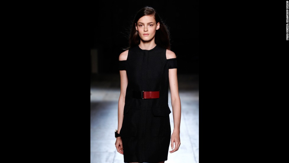 This Victoria Beckham piece was accented by shoulder cutouts and a maroon belt.