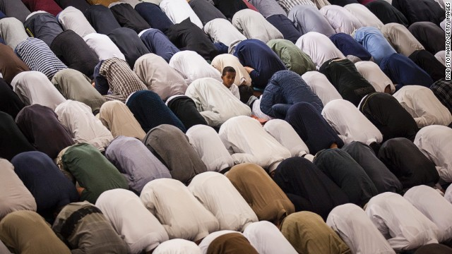 Muslim men conduct Tarawih prayers, during which long portions of the Qur'an are recited, at the East London Mosque on the evening before the start of the holy month of Ramadan on June 28, 2014 in London, England.
