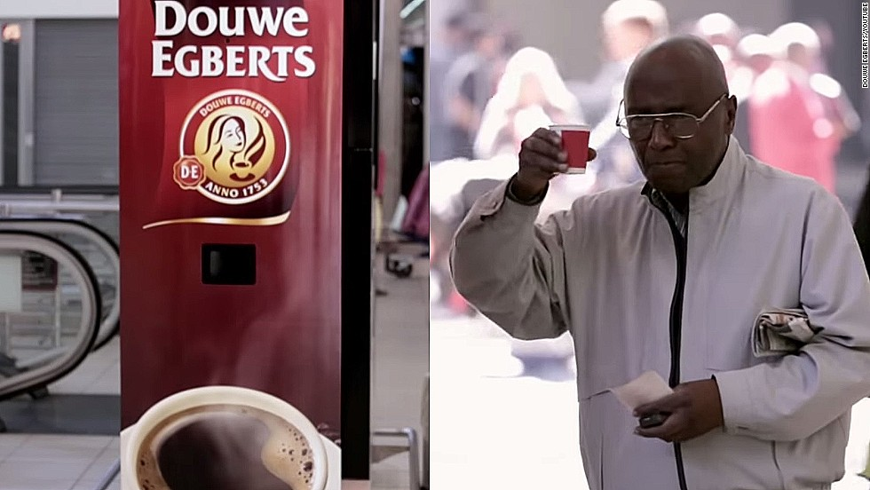 A man raises his glass (well, cup) after Douwe Egberts' yawn-activated coffee dispenser supplied him with a drink at Johannesburg Airport in South Africa.