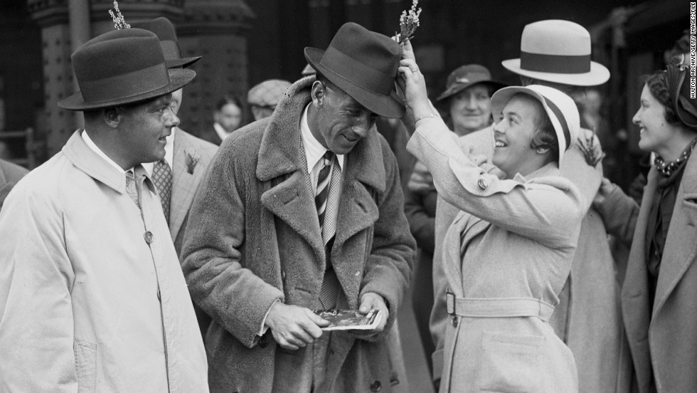 Players' wives and girlfriends have always been a part of the Ryder Cup, but their role has become more prominent as time has gone on. Here, Alf Padgham's wife lodges a sprig of lucky heather in her husband's hat at Waterloo station in London before the Great Britain team departed for the 1935 Ryder Cup in New Jersey.
