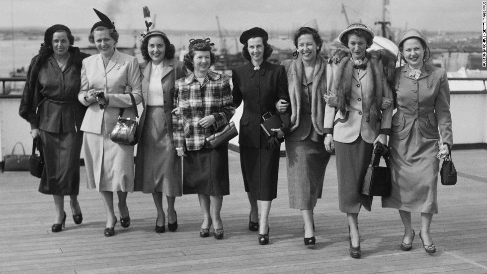 "The wives of the 1949 American Ryder Cup team have their pictures taken aboard the ""SS Queen Elizabeth"" before making the journey to Scarborough in England. The USA won the match 7-5."