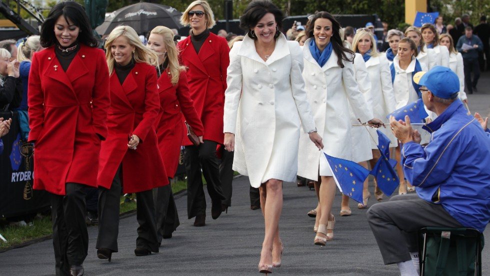 Lisa Pavin (L) and Gaynor Montgomerie (R) lead out the wives and girlfriends during the Opening Ceremony prior to the 2010 Ryder Cup in Wales.