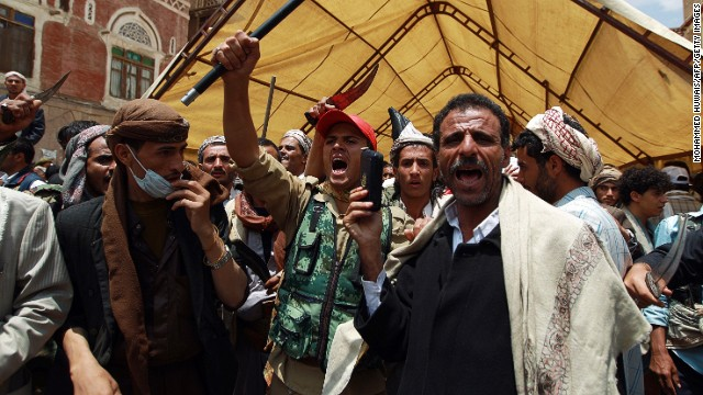 Yemeni Shiite Huthi anti-government demonstrators shout slogans during a demonstration near the government headquarters in Sanaa on September 9, 2014.
