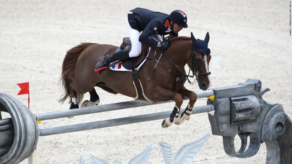 French Kevin Staut rides Reveur de Hurtebise HDC on September 3, 2014 during the Individual Jumping competition.