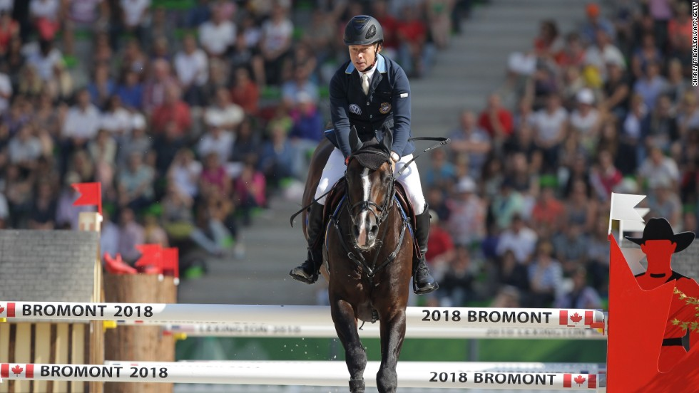 Swedish Rolf-Goran Bengstsson rides Casall Ask on September 3, 2014 during the Individual Jumping competition.