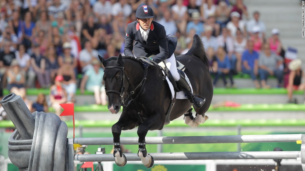 French Simon Delestre rides Qlassic Bois Margot during the Jumping competition on September 4, 2014.