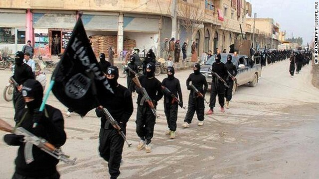 [File photo] This undated file image posted on a militant website on Jan. 14, 2014, which has been verified and is consistent with other AP reporting, shows fighters from the al-Qaida linked Islamic State of Iraq and the Levant (ISIL) marching in Raqqa, Syria.
