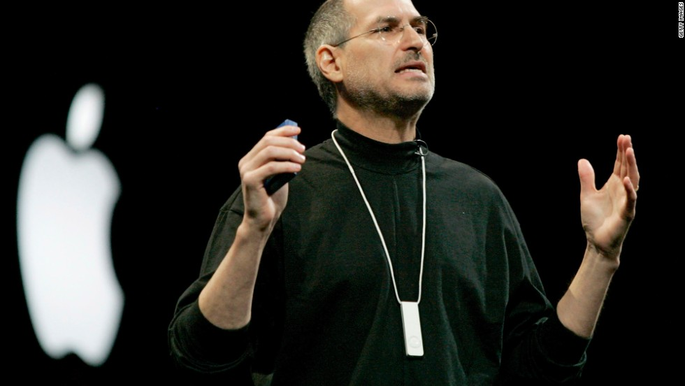 "Apple co-founder and CEO Steve Jobs introduces the iPod Shuffle, which rolled out in 2005. Considered an ""entry-level"" iPod, it was small but gave up some storage space in return and less expensive than previous models. Designed for exercise and other uses on the go, it came with a lanyard, and accessories included an armband and waterproof case. The latest model comes with a clip and costs just $49."