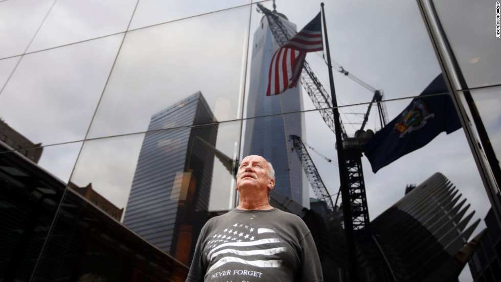 Tyrone McClave, of Bristol, Pennsylvania, looks up at One World Trade Center during a moment of silence in New York.