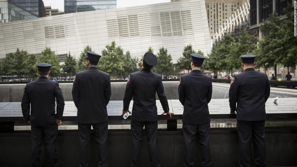 Members of the New York Fire Department take time to reflect.