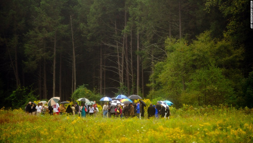 Family members gather in the rain at the impact site in Shanksville.