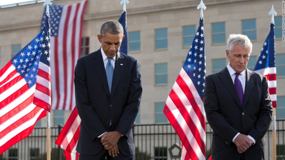 Obama and Hagel bow their heads during the ceremony at the Pentagon.