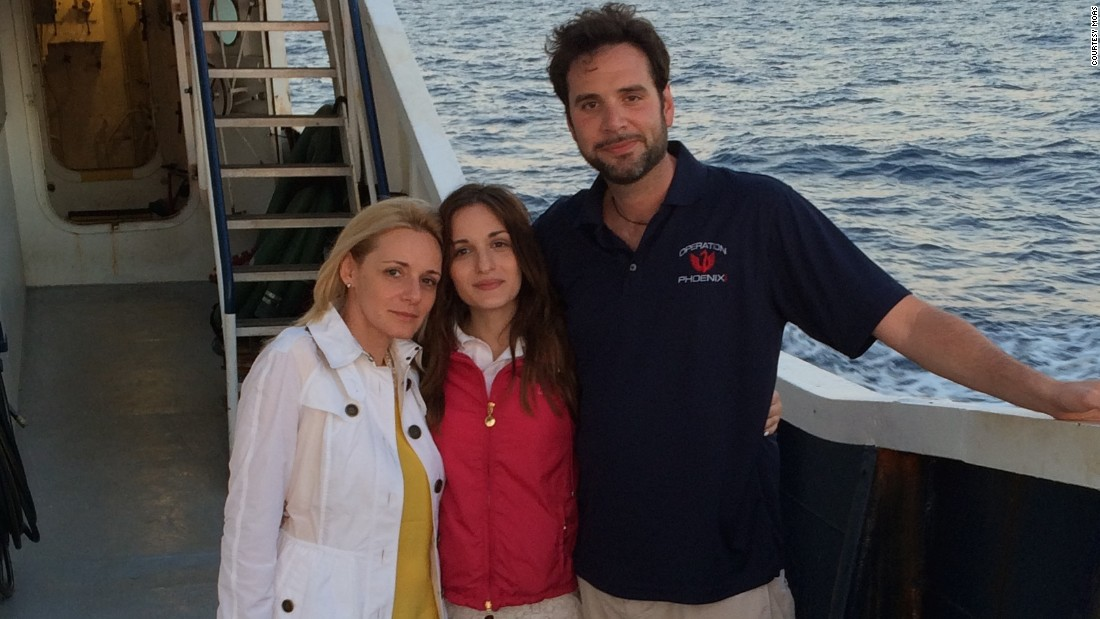 "Around 700 migrants are believed to have drowned while crossing the Mediterranean on Saturday. But the Catrambone family (Regina and Chris, with daughter Maria Luisa) are hoping to stem the loss of life by launching a 40-meter rescue ship, called ""Phoenix."""