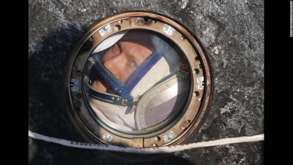 Russian cosmonaut Oleg Artemyev looks out of the capsule of the Soyuz TMA-12M spacecraft after landing near the city of Zhezkazgan, Kazakhstan, on Thursday, September 11. Artemyev and two others returned to Earth after working at the International Space Station for half a year.
