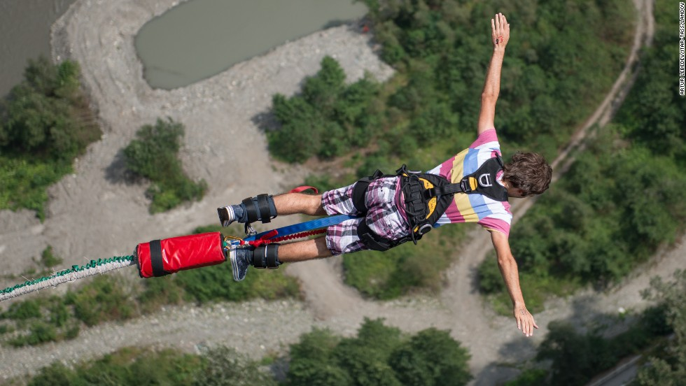 A bungee jumper leaps from a platform 207 meters (679 feet) in the air Friday, September 5, at the AJ Hackett Skypark in Sochi, Russia.